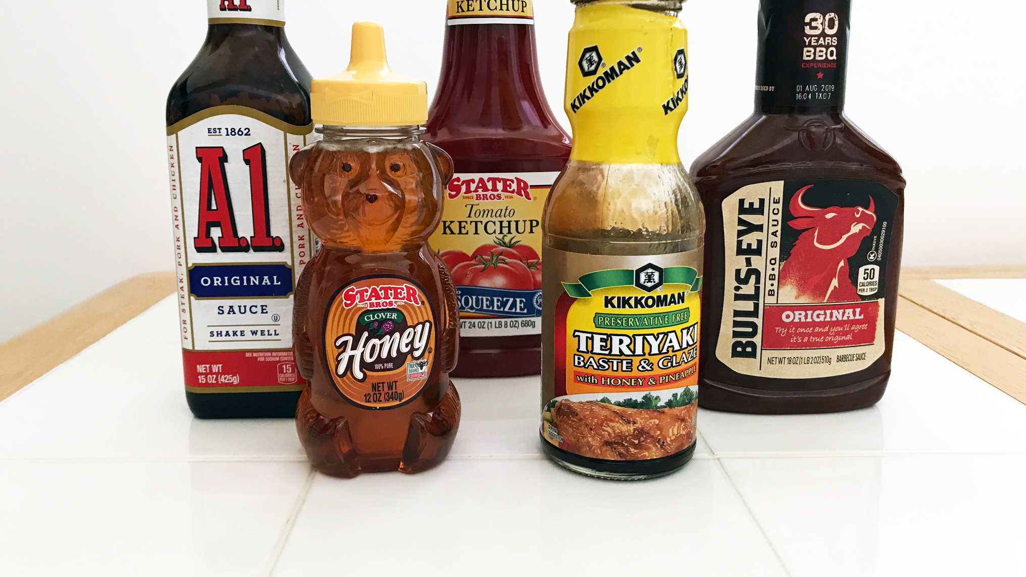 Various condiments that can be used to help flavor food; A1, Honey, BBQ sauce, Catsup, or Teriyaki sauce