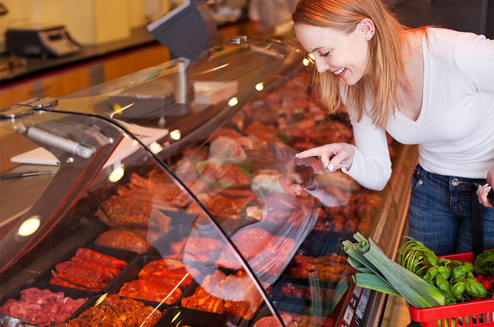 Woman selecting meat for dog food recipe