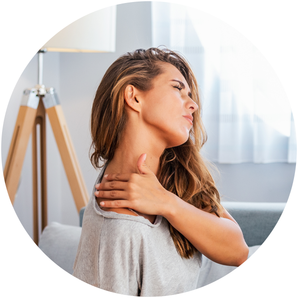 Photo of a woman with neck pain and low back pain, which can be helped with a chiropractor