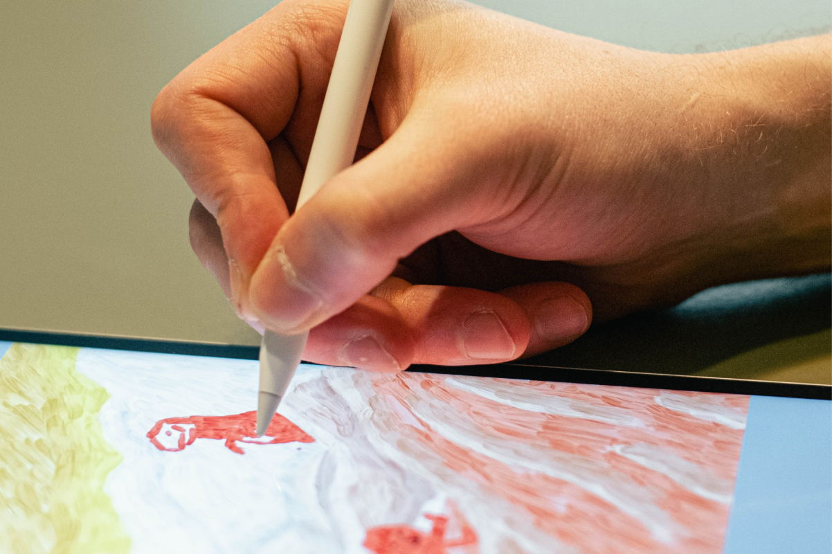 A close up of someone making art on an iPad