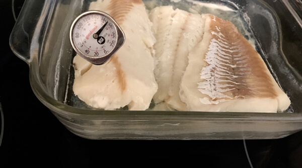 Baked Cod in glass dish with thermometer