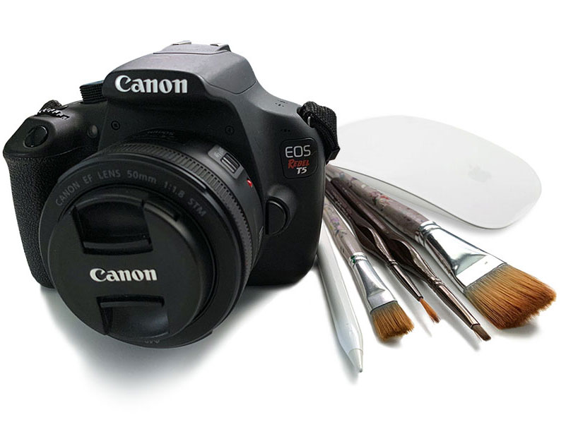 Canon Digital camera, apple pencil, apple computer mouse and paintbrushes