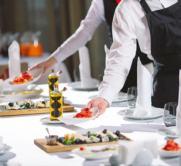 Restaurent waiters serving