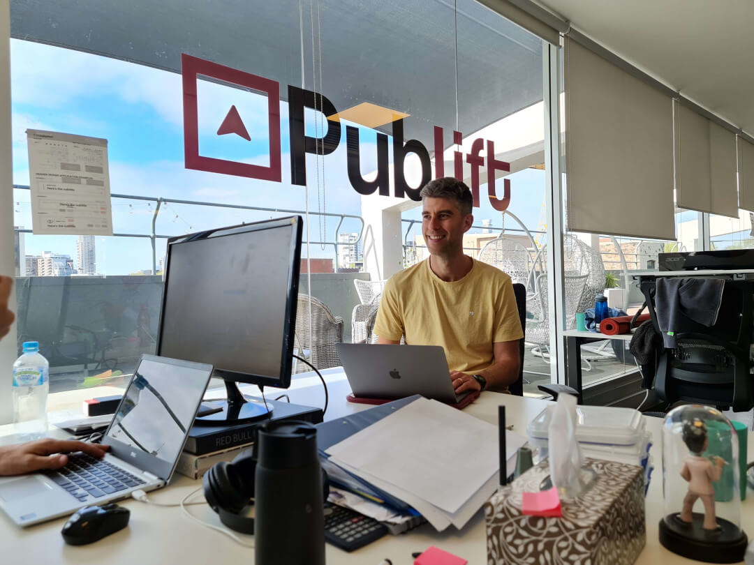 Publift CEO Colm at his desk in the office