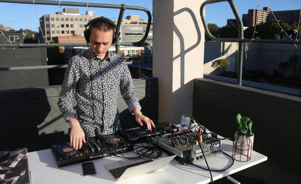 DJ at the UnLtd. charity fundraising event on the balcony at Publift HQ