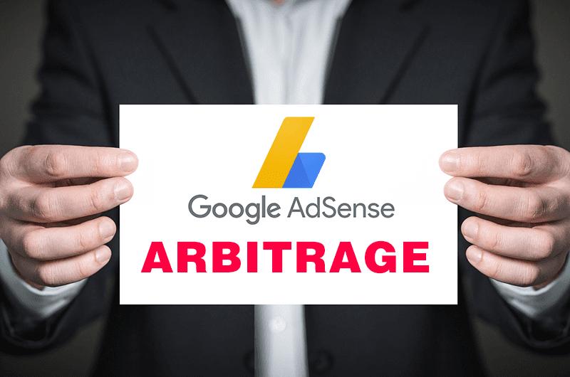 Hands holding Google AdSense Arbitrage Sign