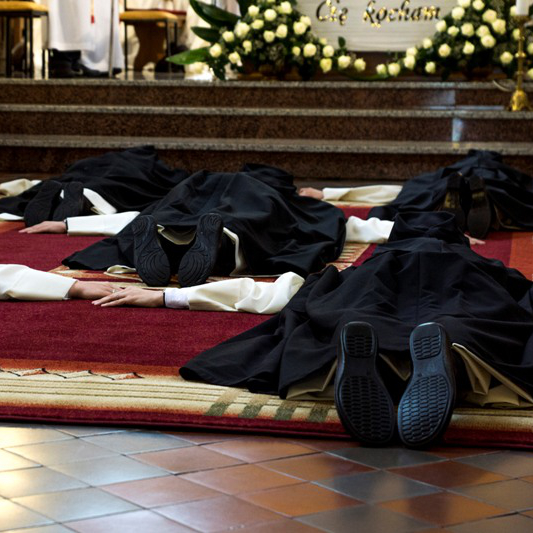 Sisters prostrating before the altar during their Final Vows.