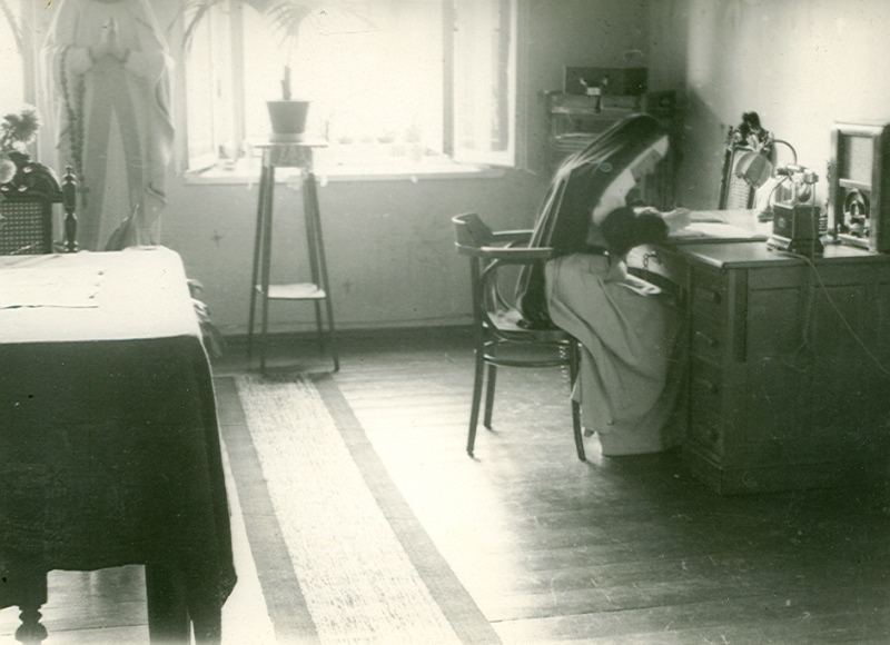 Sister Julia busily working by the desk.