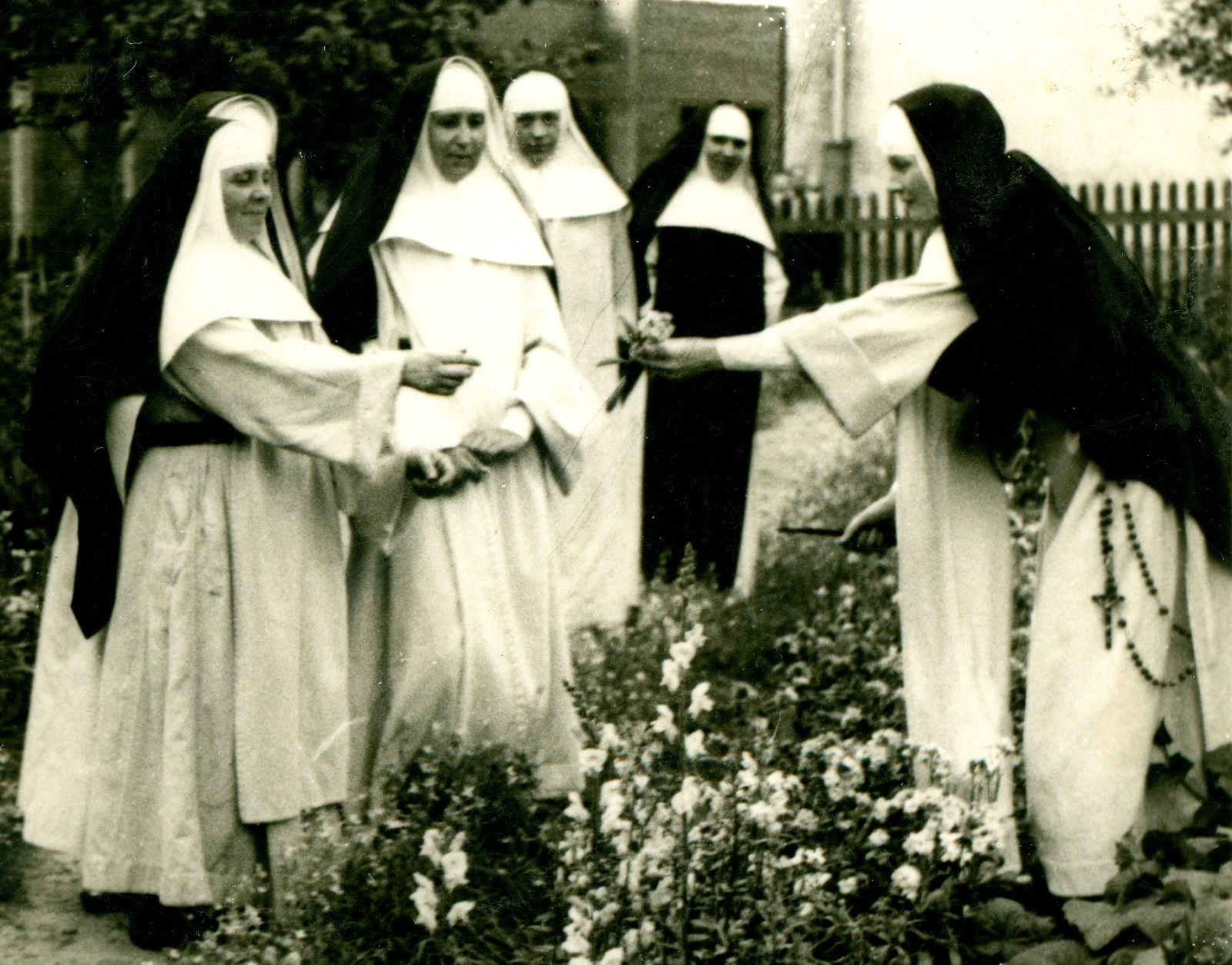 Blessed Julia with her Sisters in the garden.
