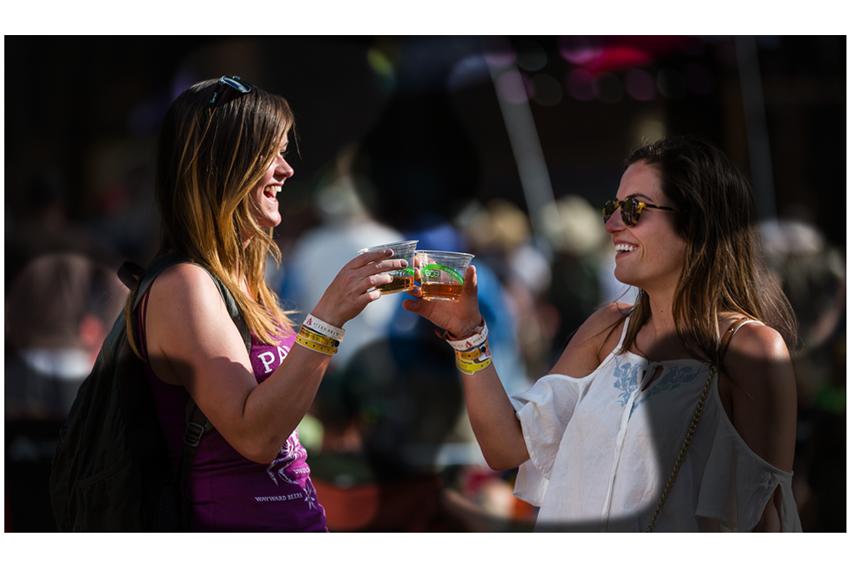 women sharing and enjoying wine