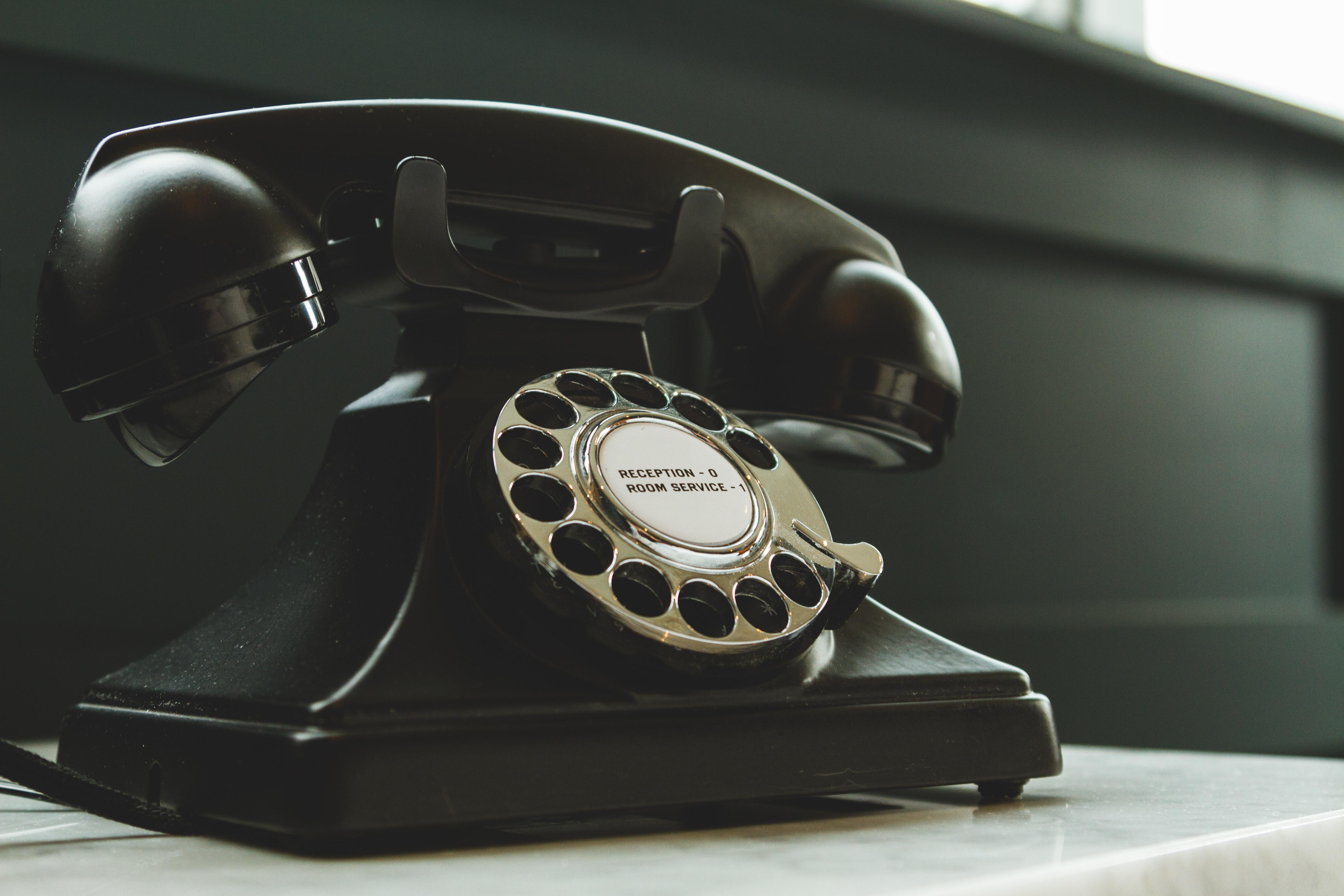A black classic turn dial telephone