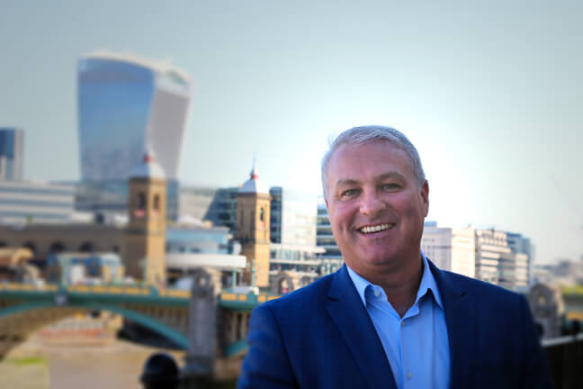 Our CEO with London skyline backdrop