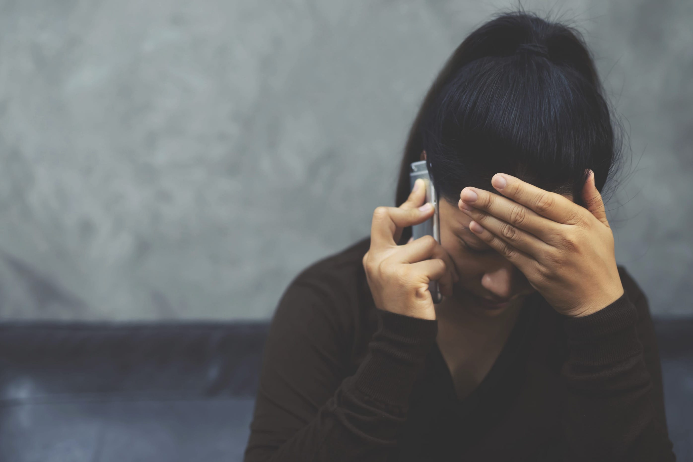 Stressed woman on phone