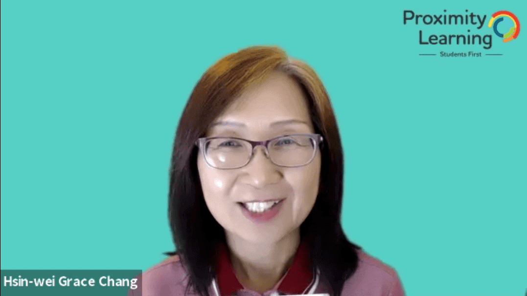 Proximity Learning teacher smiling in front of a virtual blue Zoom background