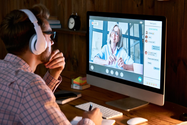 Man having digital conversation on computer with lady