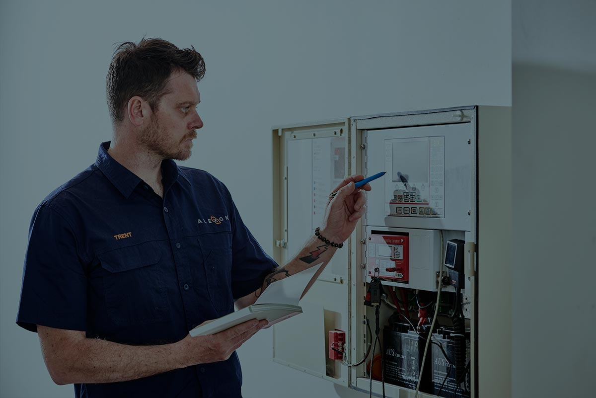 An Alexon electrician confirming the routines on a control panel.