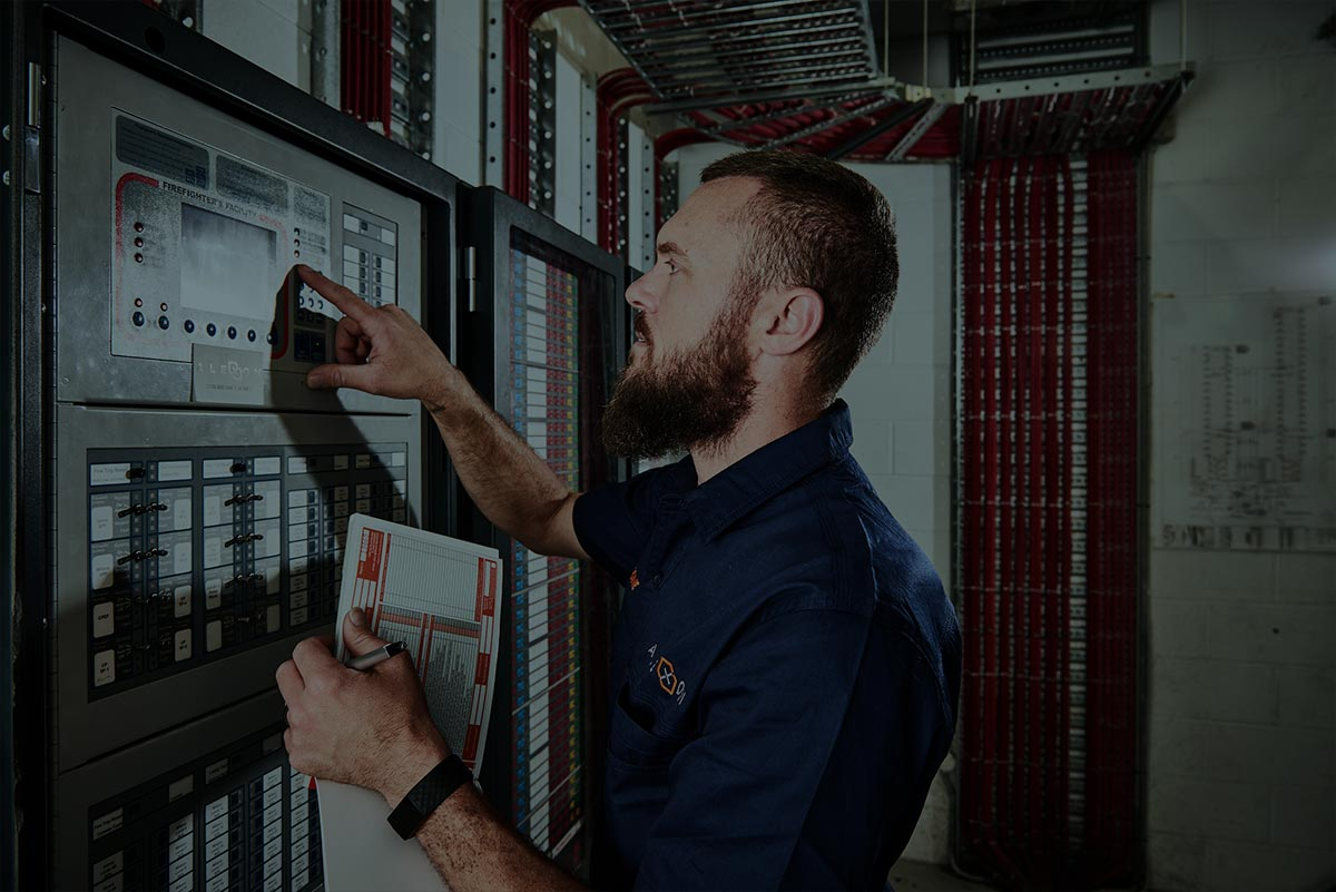 An Alexon employee checking the routines of a Control Panel System.