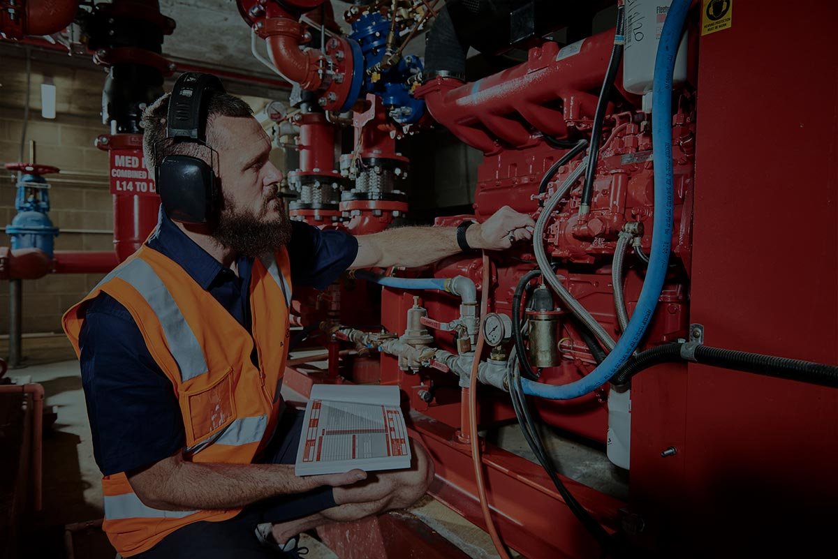 An Alexon employee running tests on some fire safety equipment.