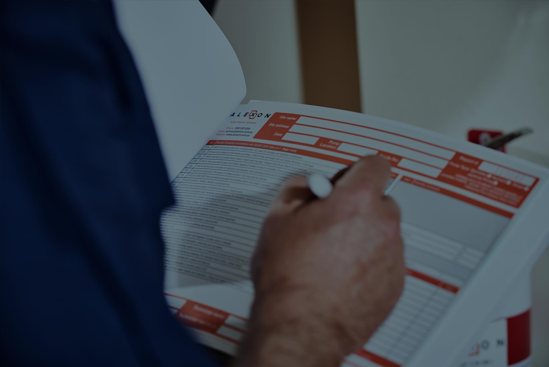 An Alexon employee completing a maintenance report.
