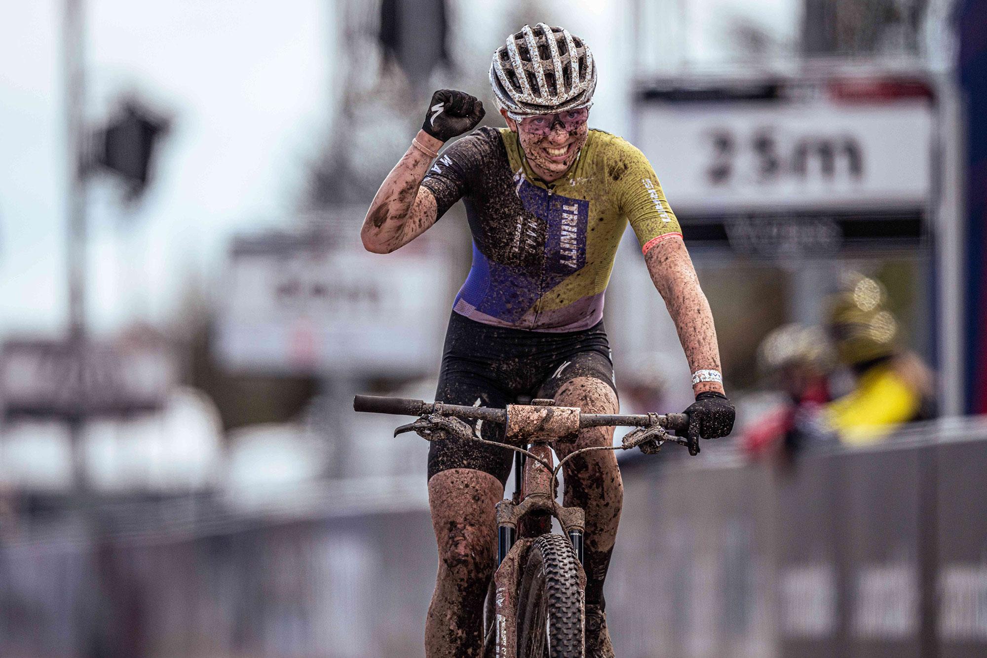 Female cyclist from Trinity Racing winning on mountain bike