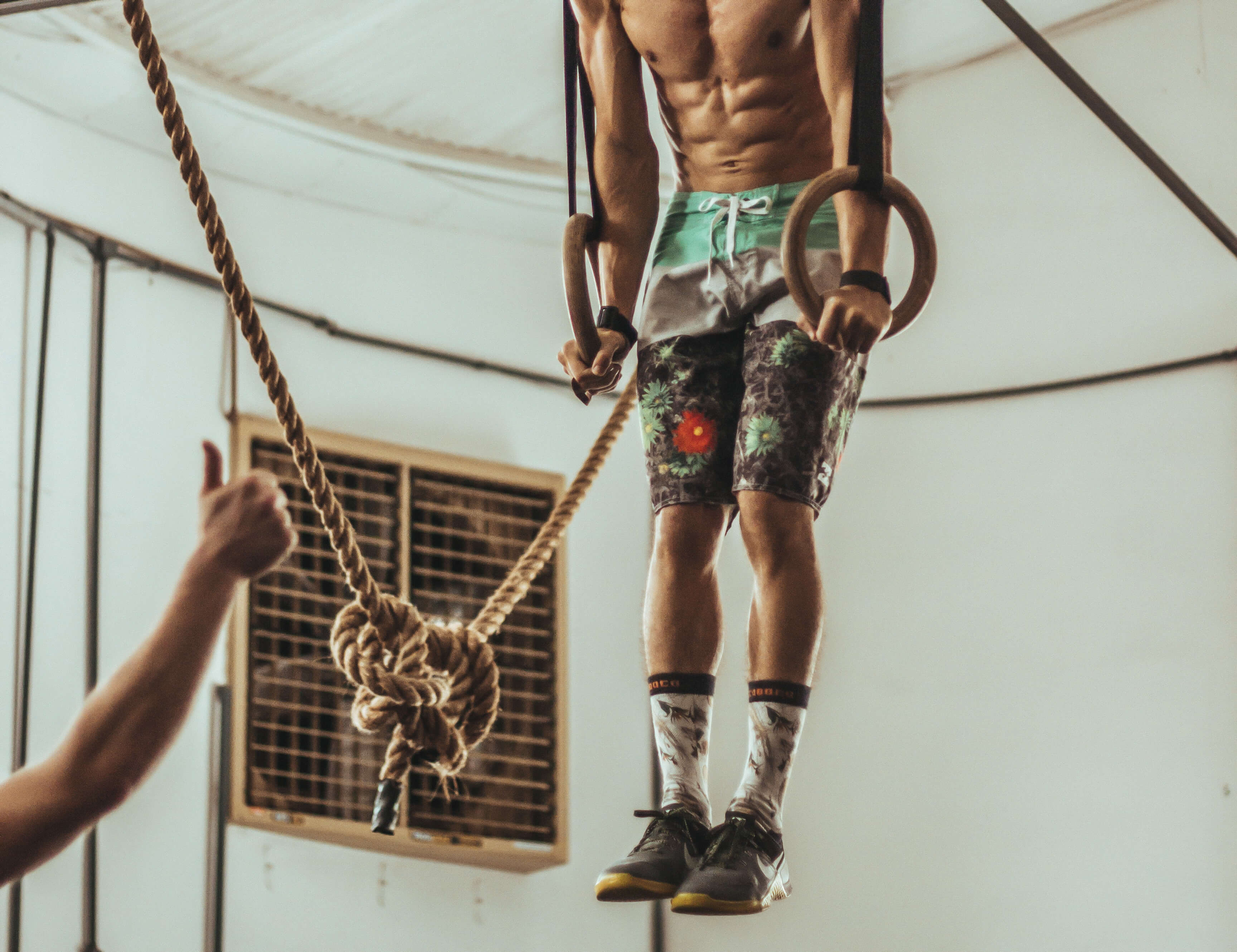 Male crossfitter training muscle ups