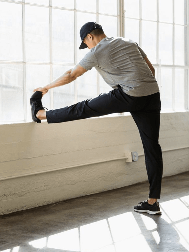 Image of man with a cap stretching
