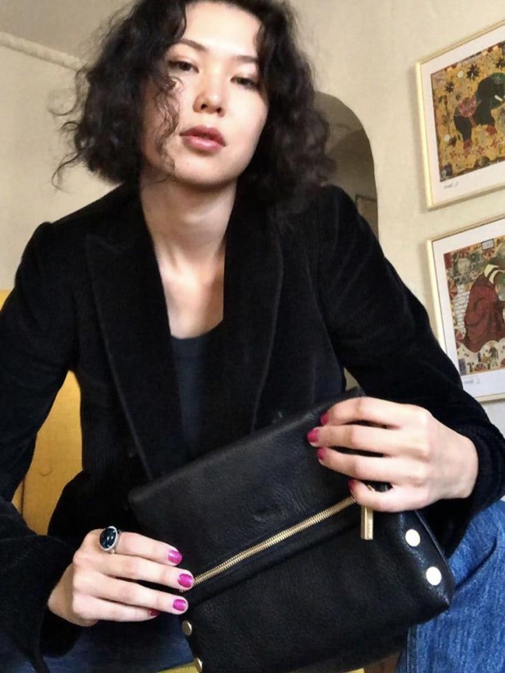 Woman holding a handbag