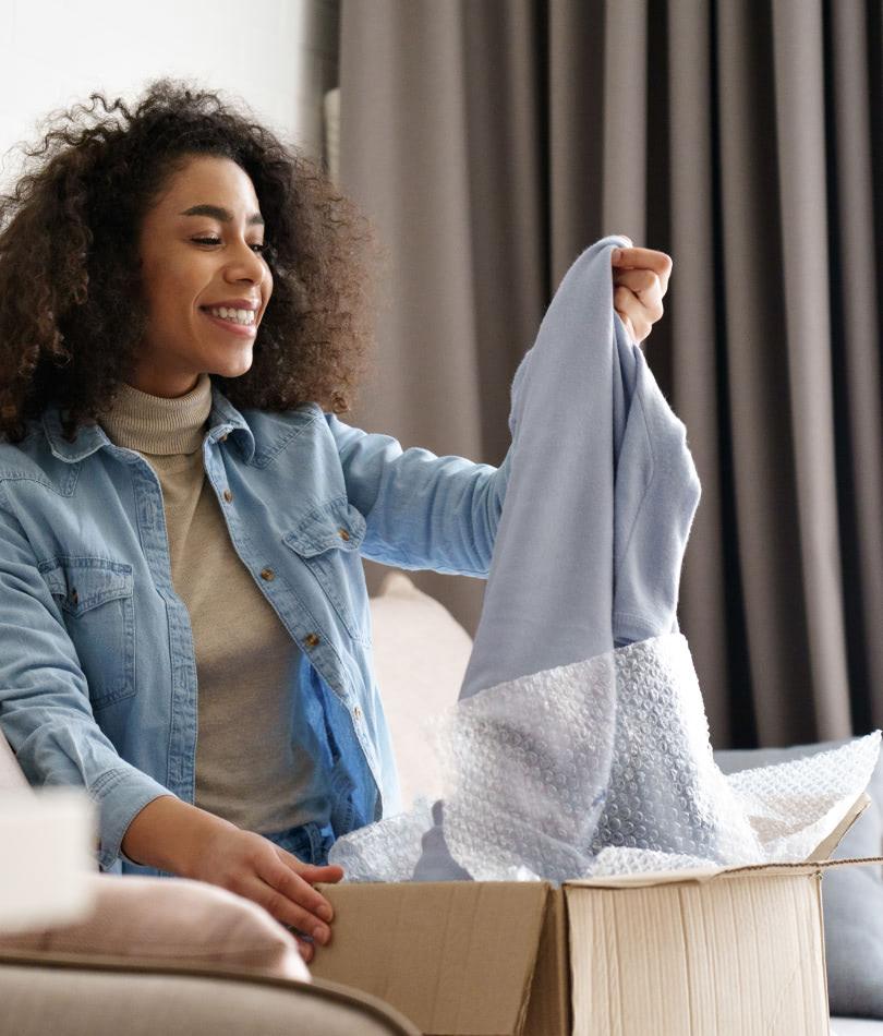 Woman opening product box