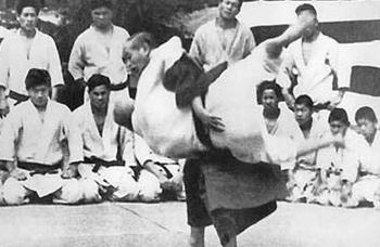 Vintage judo photo of Jigoro Kano throwing.