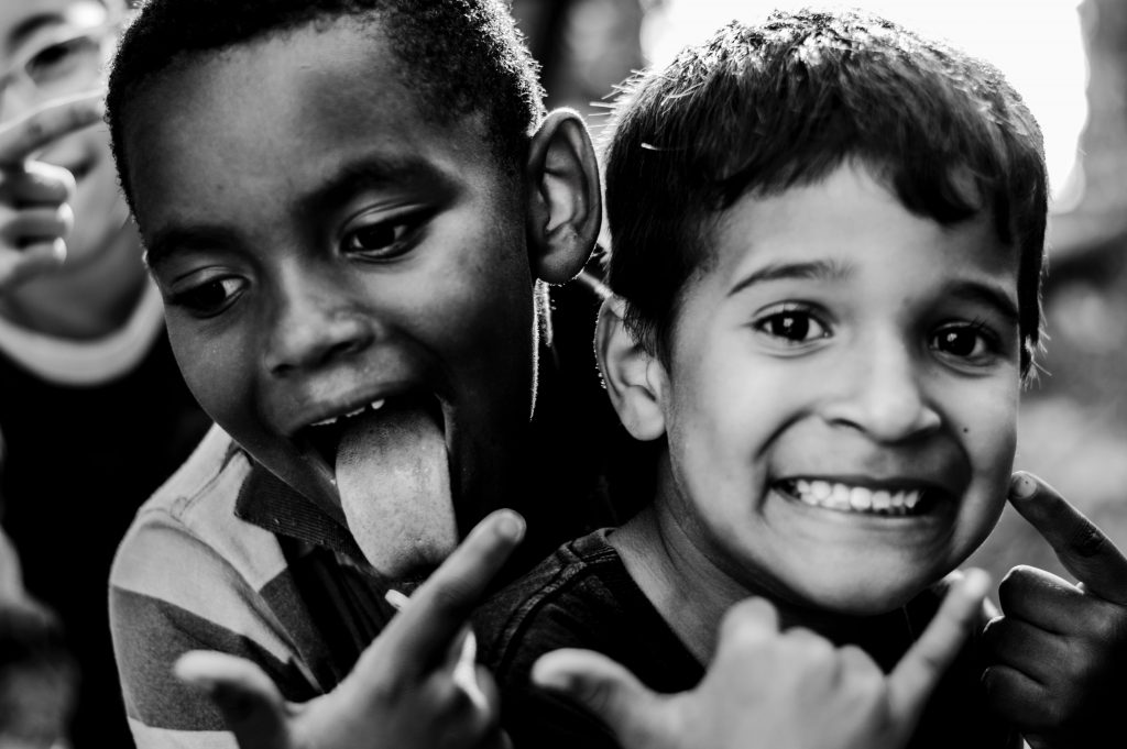 black and white pic of boys having fun.  the low fodmap diet should be supervised by a dietitian when working with children