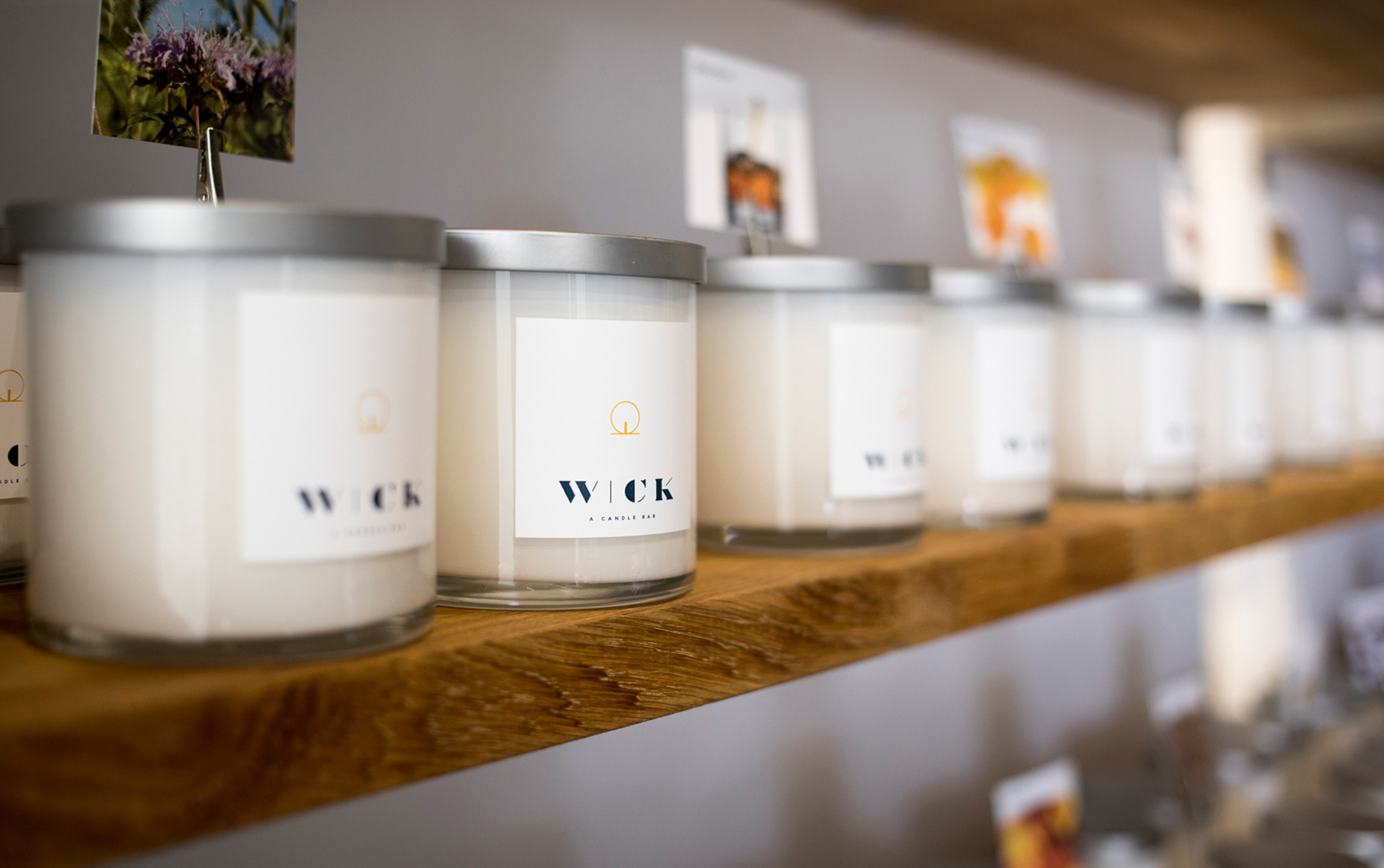 Photo of store shelf, showing single-scent candles from Wick