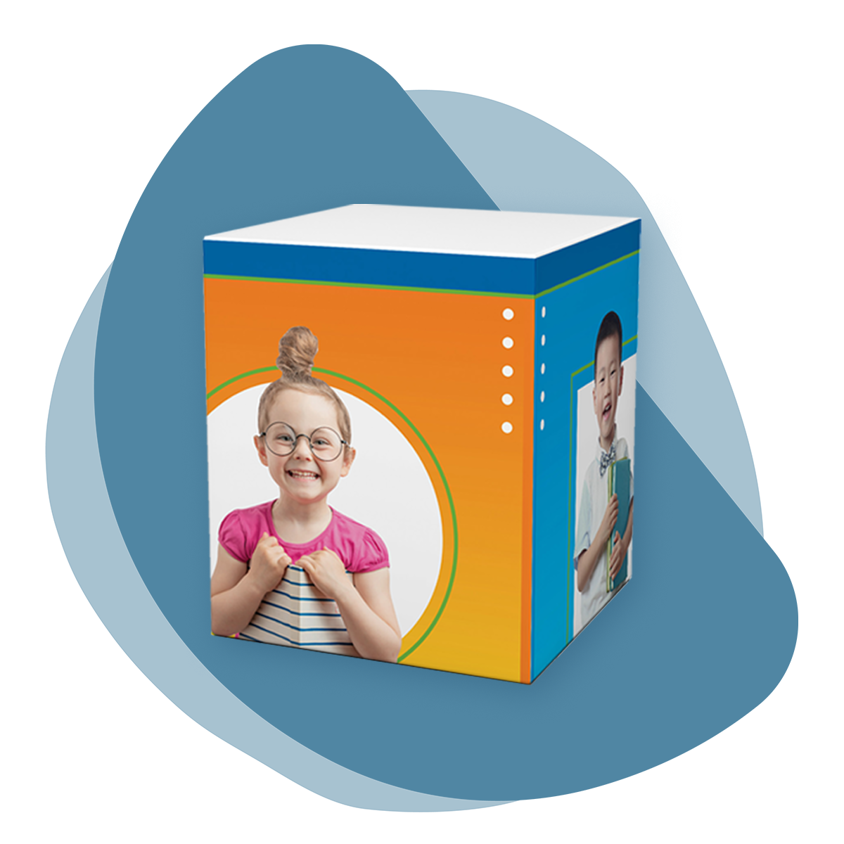 Organic blue splotch shape with a mockup of a box overlaid. The box is an even cube shape, photographed on an angle, and displays one side with an orange-yellow gradient and another with a teal-blue gradient. There are images of young children on each side, holding books and smiling, with white shapes behind them. The top border of the  box is a darker blue, and there are white dots along some of the edges.