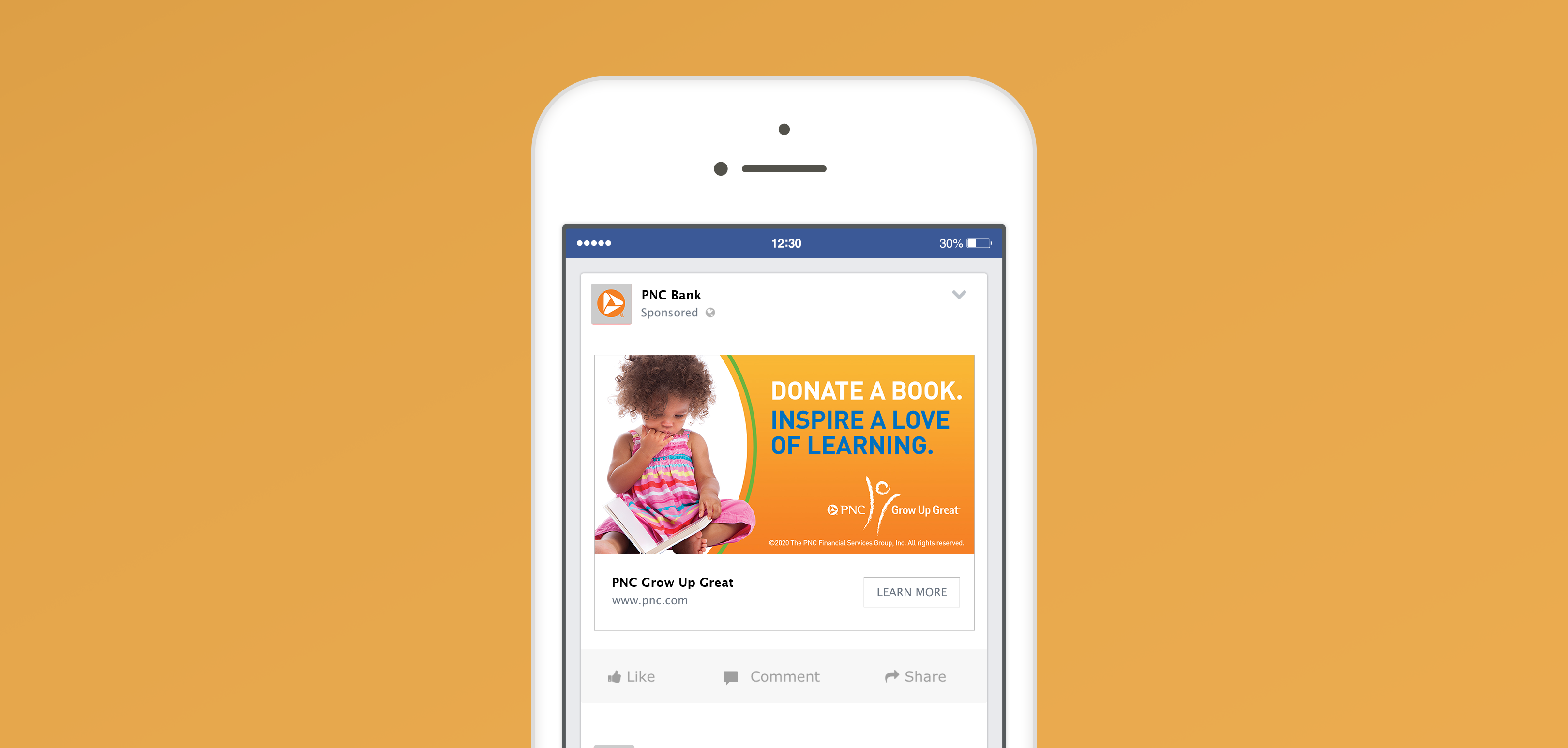 """A mockup of an iPhone over a mustard background. The phone features a Facebook post that consists of a yellow-orange gradient background and an image of a child holding a book. The image headline is """"Donate a book. Inspire a love of learning."""""""