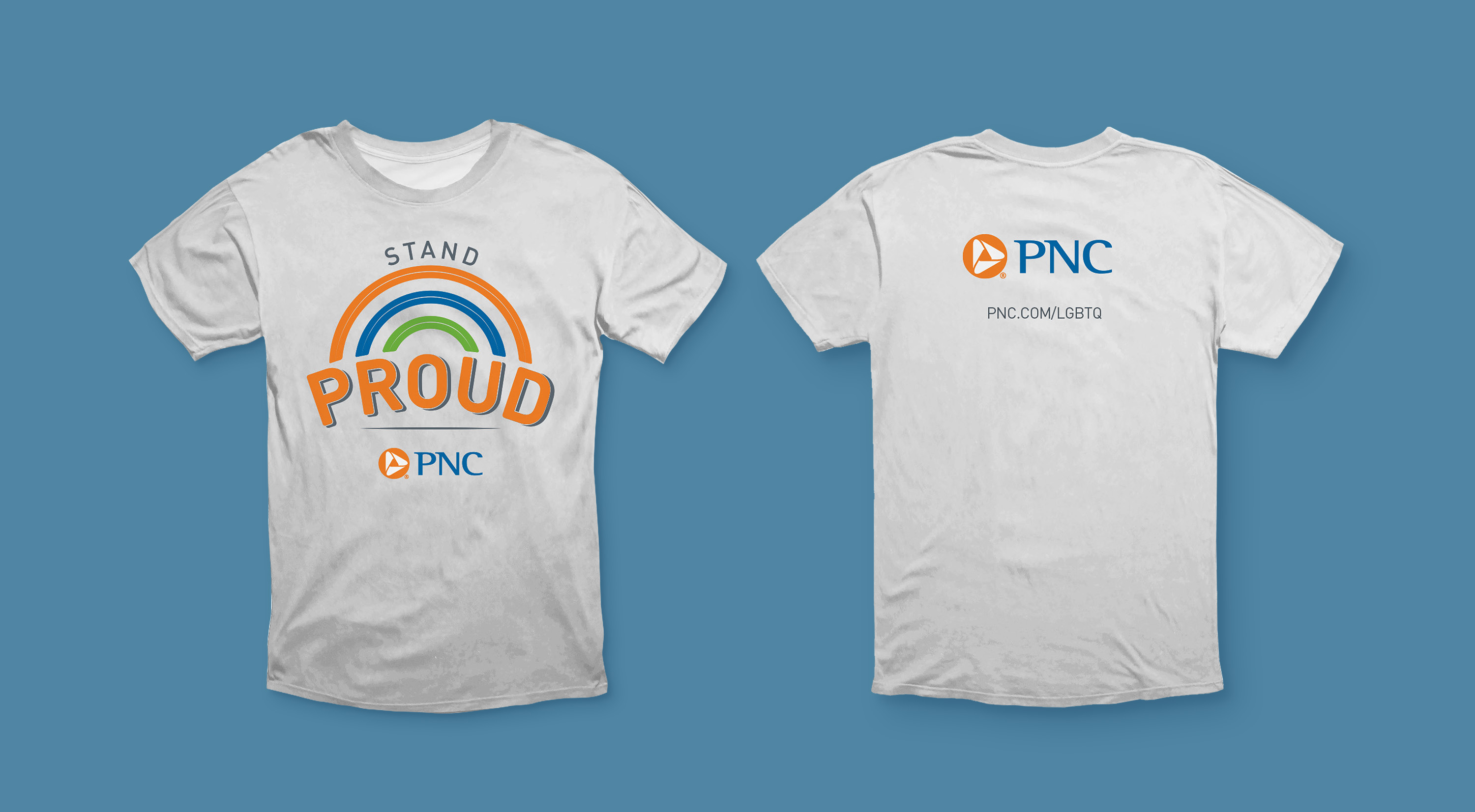 """A mockup of the front and back of a light gray t-shirt over a blue background. The front features a large rainbow graphic in orange, blue, and green, with the words """"Stand Proud"""" and the PNC logo. The back features the PNC logo and a URL reading """"pnc.com/LGBTQ."""""""