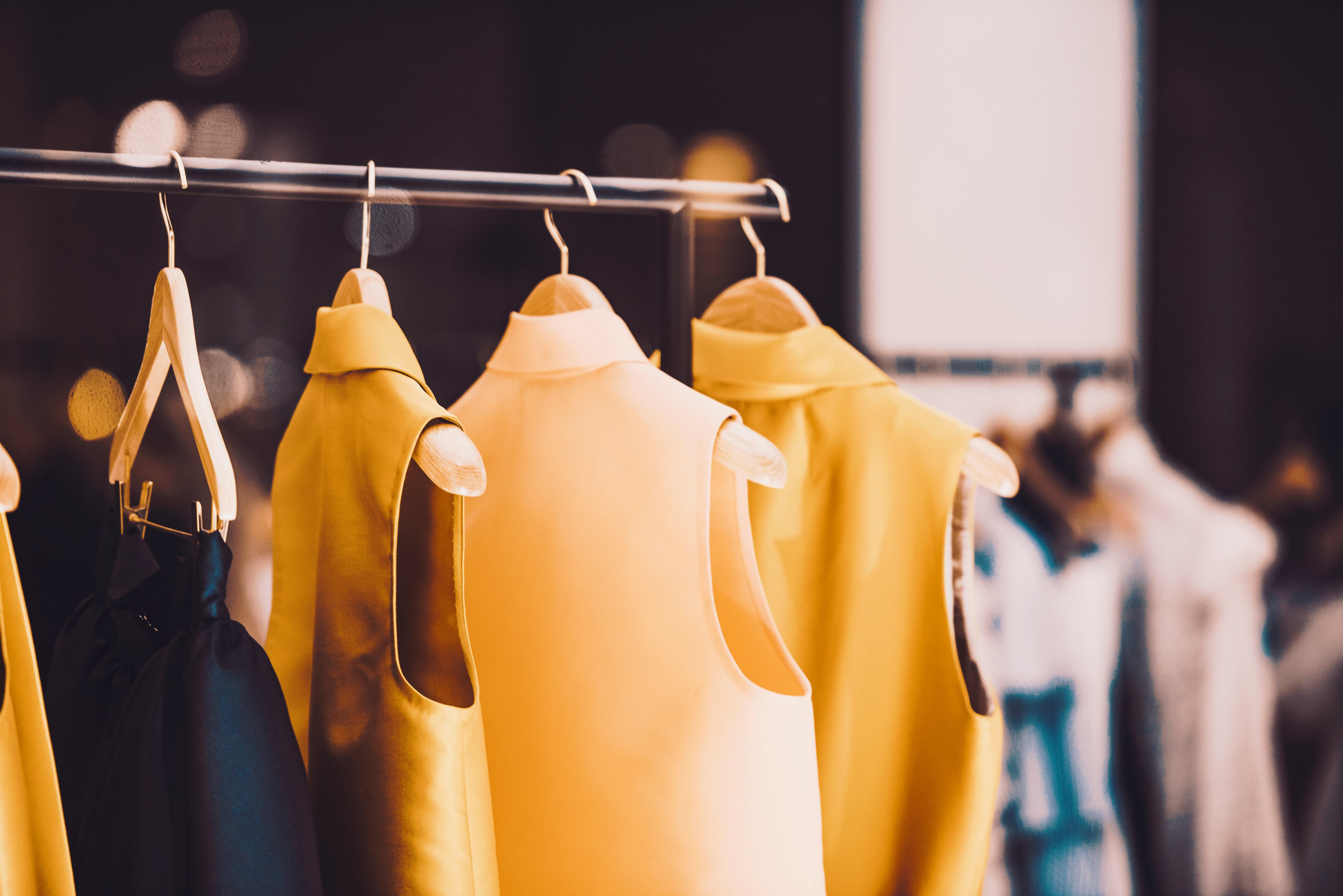 Fashion brand display of a a rack of clothing. Brands should take steps to reduce waste