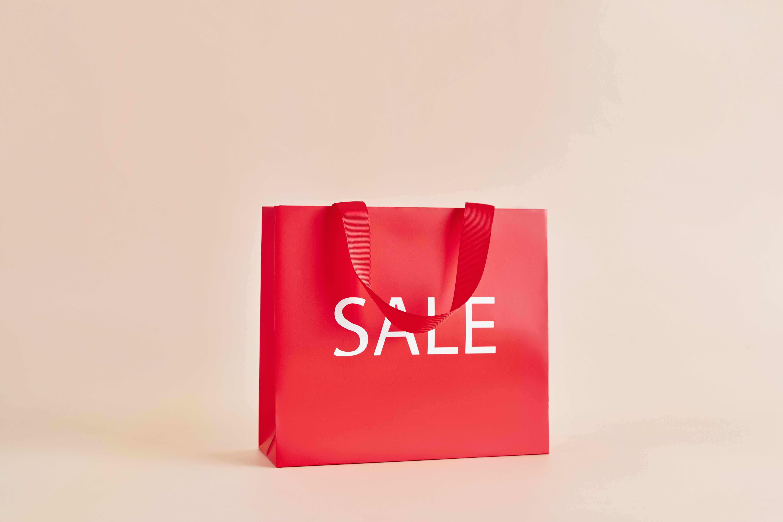 "A fashion brand's shopping bag that says ""sale"""