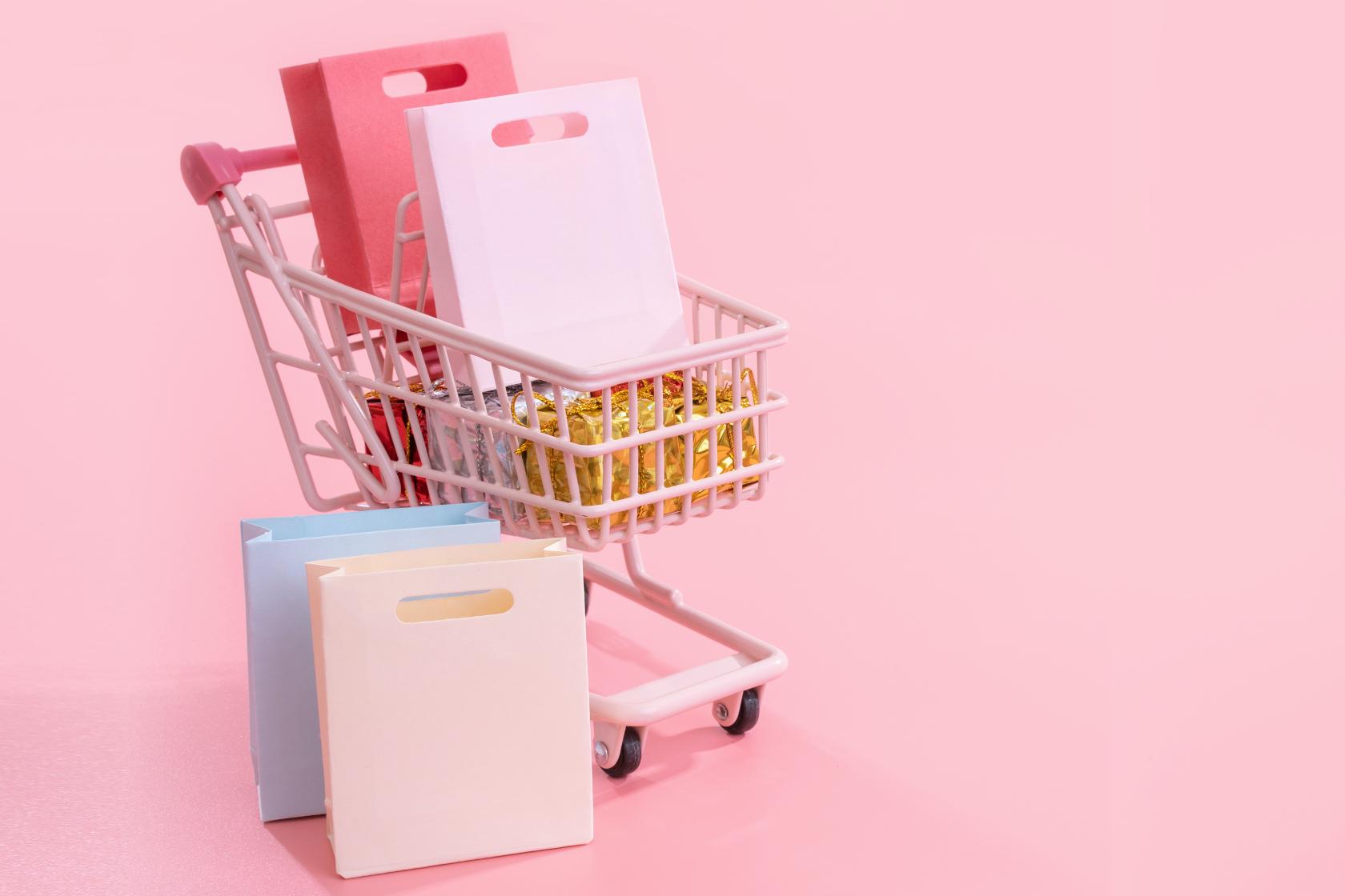 Shopping cart full of fashion shopping bags