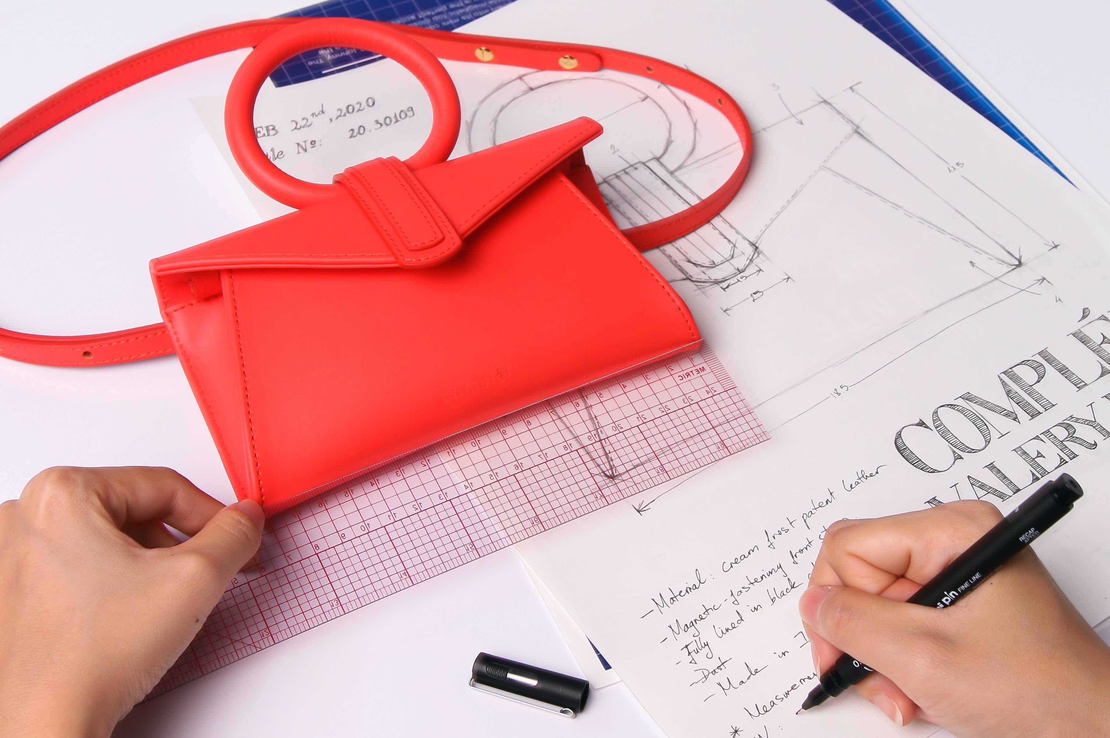 Handbag designer sketching a bag