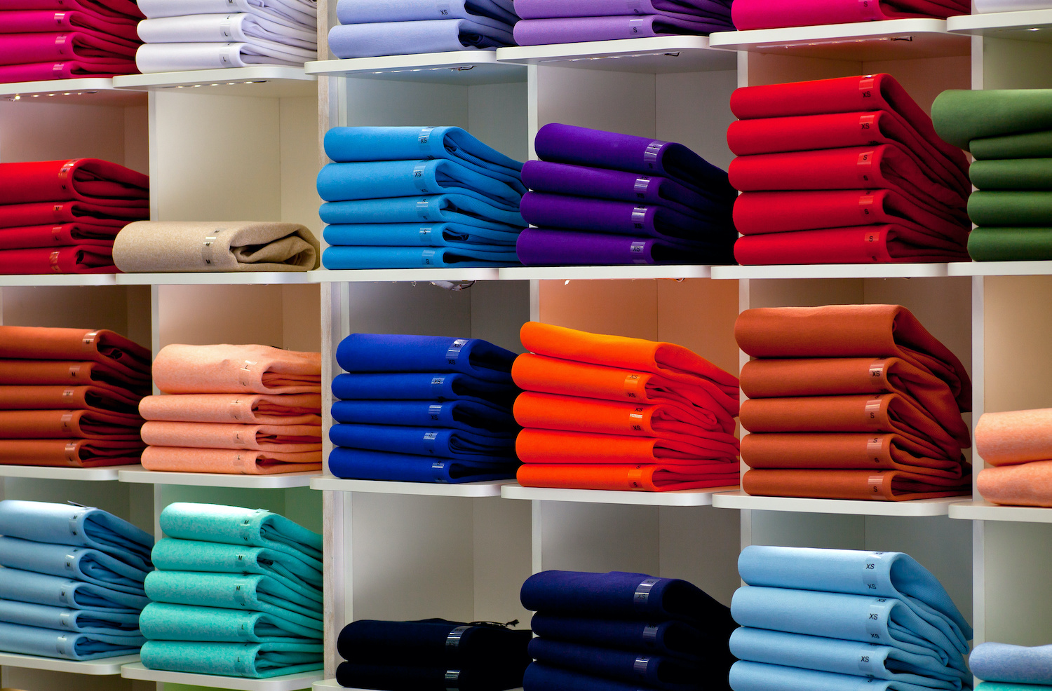 stacks of clothes on retail shelves