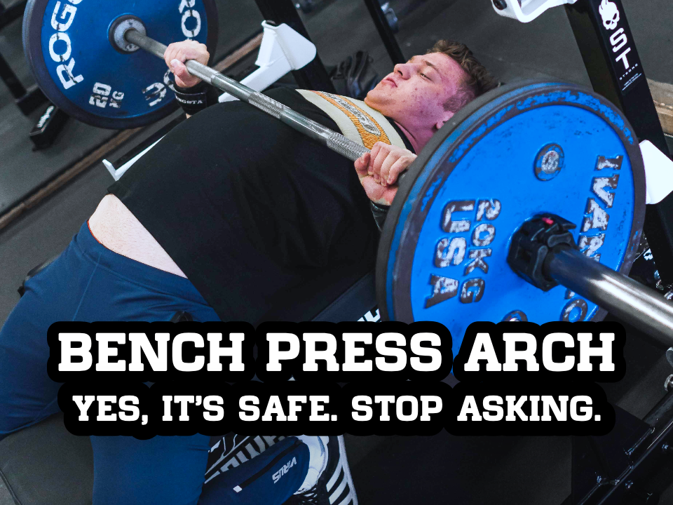 man bench pressing with arched back