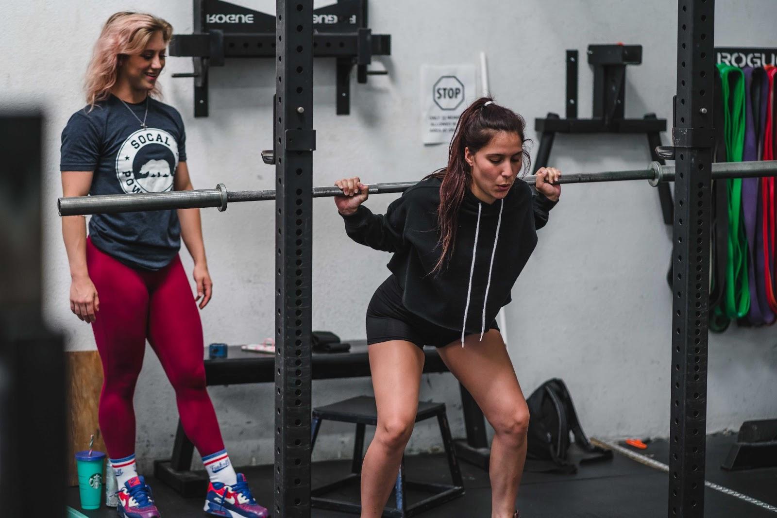 Woman performing barbell squat