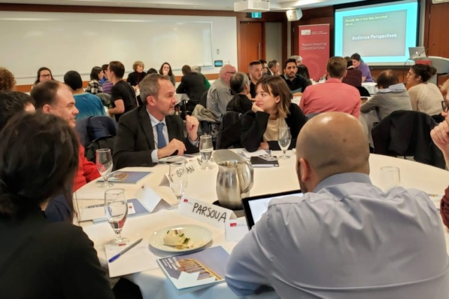 Participants of Century Initiative's dialogue event having a table discussion