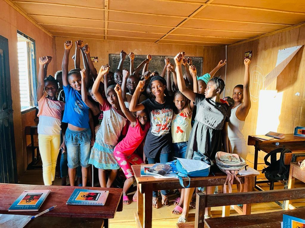 The Love Learn & Play Girls' Club, Sierra Leone, celebrating their mission to flourish!