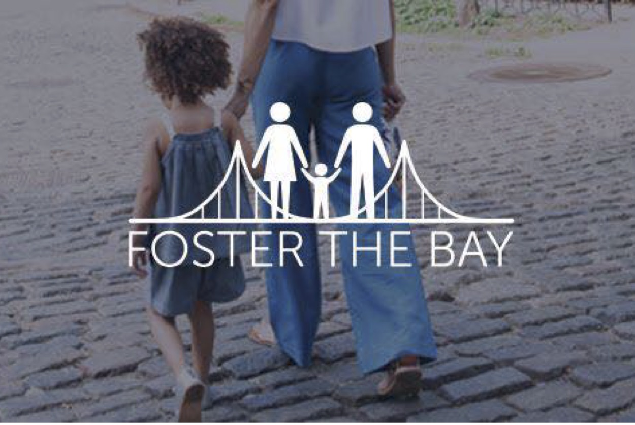 Foster The Bay logo over an image of a toddler being led by an adult.