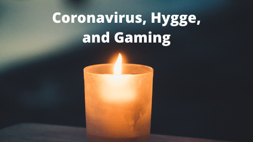 """A candle aflame with the words """"Coronavirus, Hygge, and Gaming"""" above"""