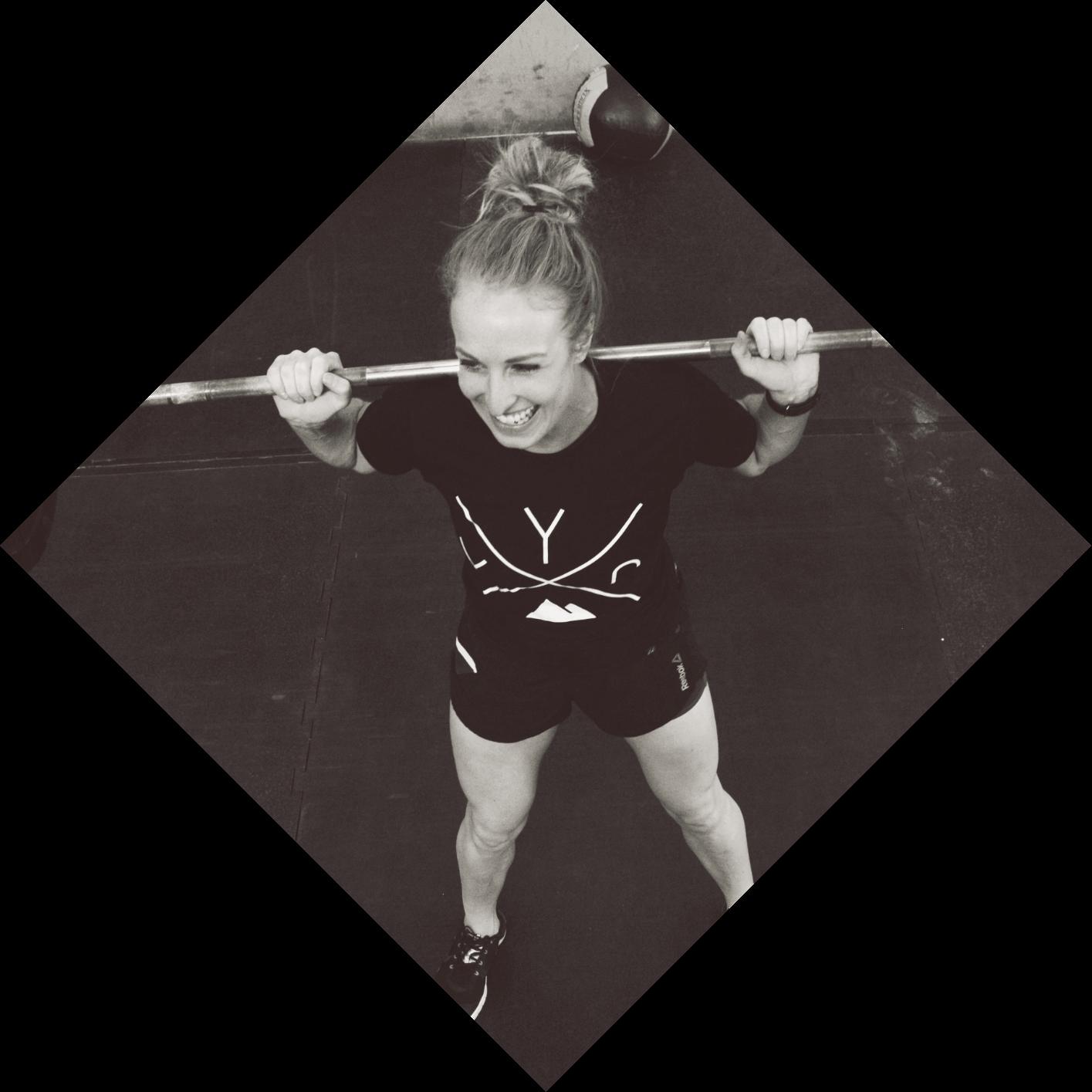 smiling woman, lifting weights at gym