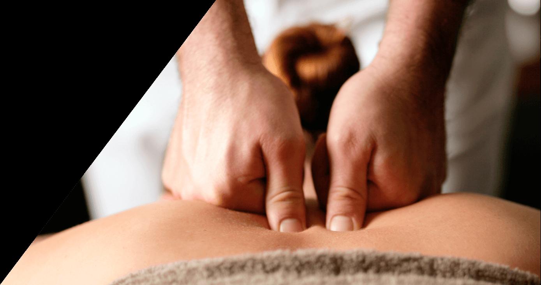 Woman lying down receiving back massage