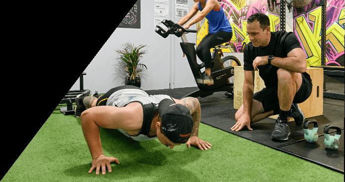 Man doing push ups next to personal trainer Daniel Godsmark