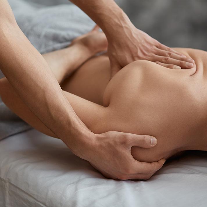Man receiving a shoulder and back massage