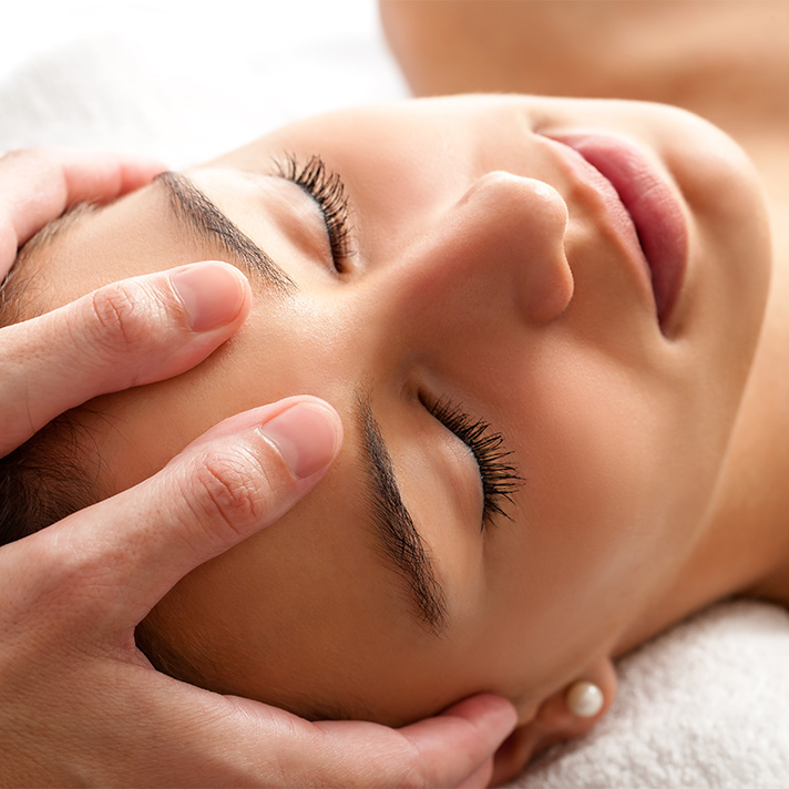 Relaxed woman receiving a head massage
